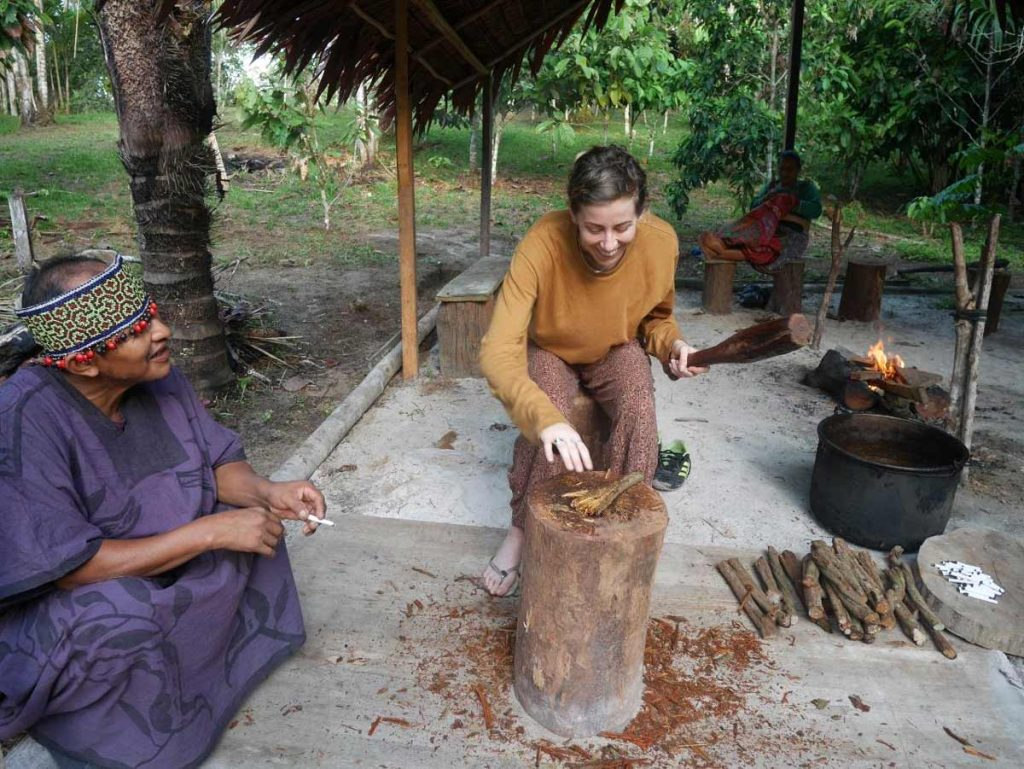 Ayahuasca preparation! Guest pounding Cielo ayahuasca vine cuts, supervised by Shipibo Maestro Ronel.