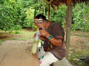 Don Armando blowing Mapacho smoke into the Camalonga brew